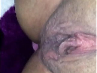 Amber Pink slips out of her uniform to brush her pussy