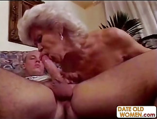 granny with sexy tits is on all fours, ready to take on and engulf
