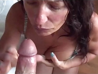 Brunette Milf Takes a Facial At Home